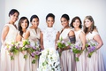 Bride in high neck lace wedding dress bridesmaids in champagne pink v neck bateau dresses purple
