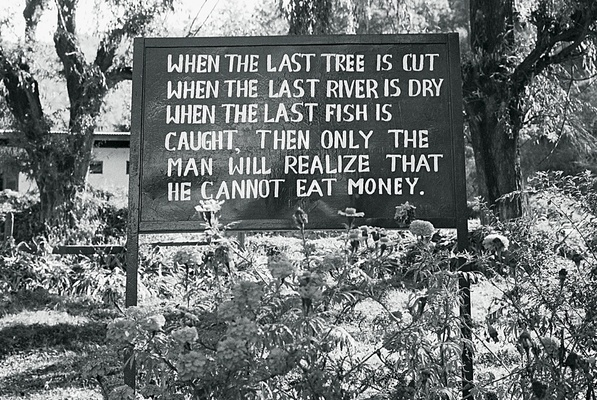 Black and white picture of proverb sign in Bhutan