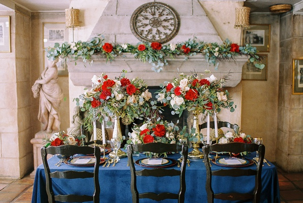 beauty beast movie styled wedding shoot navy tablescape red white flower arrangements chateau small