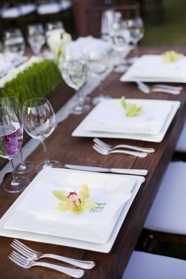 Orchid on monogrammed napkin at reception
