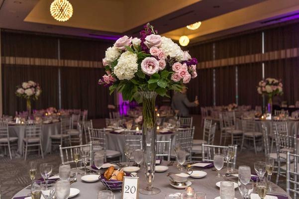 wedding reception silver chairs purple lighting grey linen white hydrangea pink rose centerpiece
