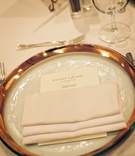 Gilded glass place setting with menu card