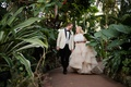 bride in martina liana layered blush ballgown with groom in cream tuxedo jacket, greenhouse