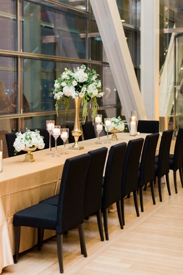 clinton presidential library wedding, black chairs, long tables, gold linens