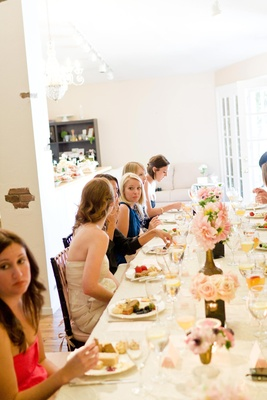 Guests sit at long table to eat