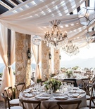 Malibu Rocky Oaks Vineyard wedding reception round tables chandeliers geometric orbs drapery wood