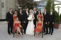 Bride and groom with orange bridesmaids and groomsmen