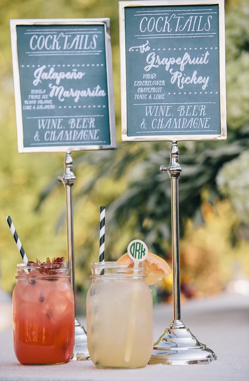 Signature cocktail chalkboard menu and striped straws