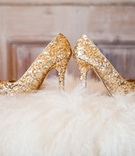 Gold glitter platform wedding shoes on white fur