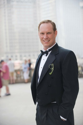 Groom in a black tuxedo and bow tie