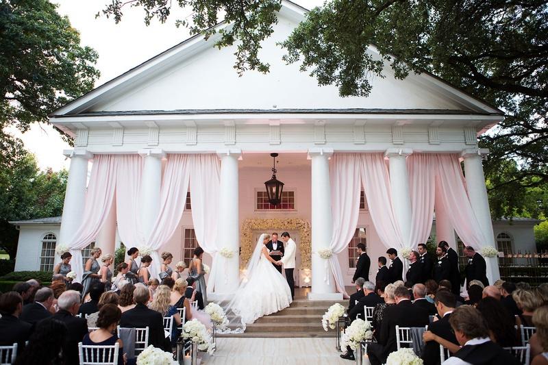 Wedding ceremony on porch of venue outdoor ceremony lee park arlington hall pink drapery