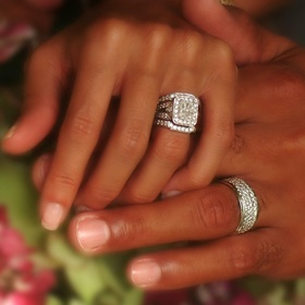 African-American couple wearing rings