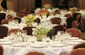 Reception ballroom with different colored tulip centerpieces