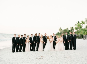 Bride and groom with bridal party on a beach in Naples, FL
