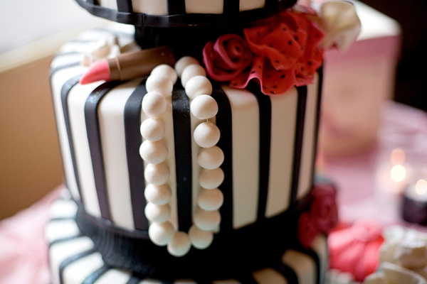 Black and white striped cake with pearls and lipstick