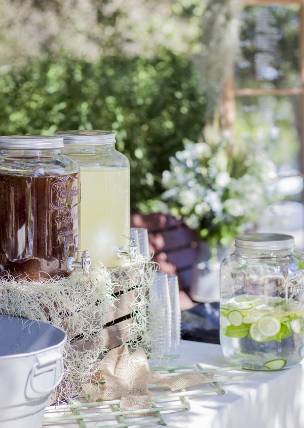 juice fruit infused water rustic outdoor setting lemon lime water white linens