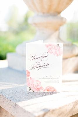 Wedding vow renewal program with watercolor pink rose design