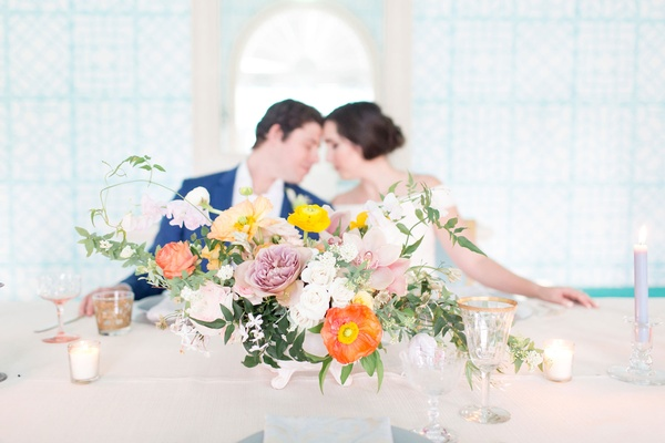 The Confused Millenial wedding shoot low centerpiece arrangement freshly picked vibe glassware
