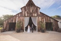 Wedding reception in San Luis Obispo rustic winery vineyard with vintage barn bride in wedding dress