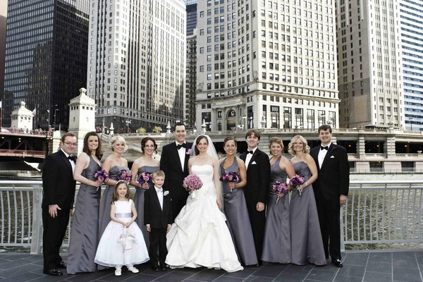 Bride and groom with wedding party in front of skyline