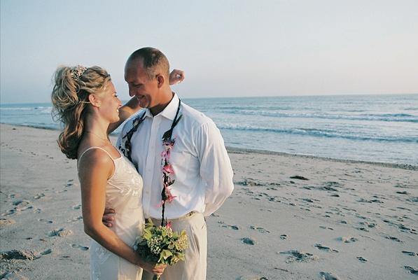 Casual bride and groom on San Juan Capistrano beach