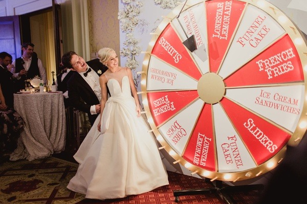 bride and groom at after party red and white spin game light slider french fries funnel cake drinks