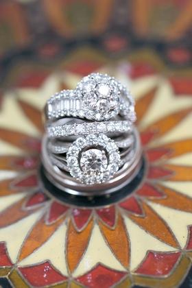 Halo diamond ring with eternity band and another diamond ring