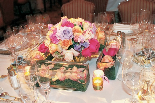 small table bouquet surrounded by floating flowers