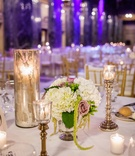 Mercury-glass candle holders and floral centerpiece