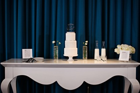 Three-tier white cake table
