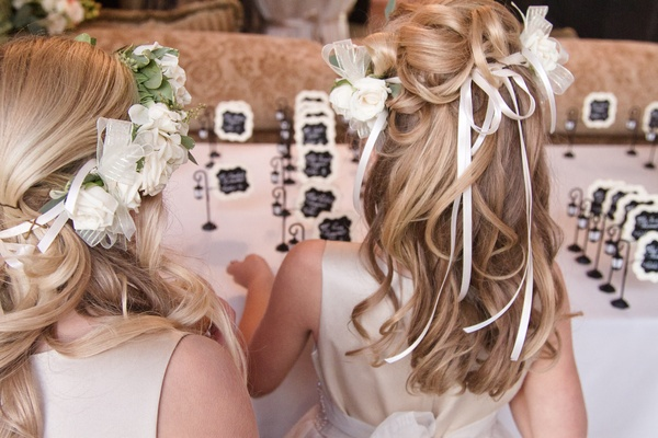 Blonde flower girls with curled hair and flower crown