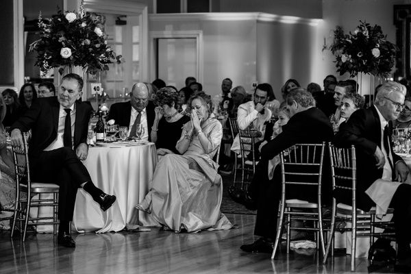 black and white photo of wedding guests at tables, bruce bochy at wedding of duane kuiper's daughter