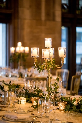 gold candelabra with leaves intertwined, small pillar candles