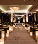Candles on aisle runner ribbon country club ballroom natural winter chuppah ceremony structure