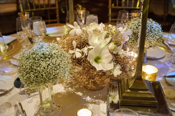 miniature floral arrangement centerpieces with white flowers and a small amount of greenery