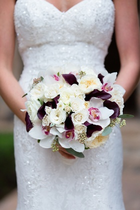 Bouquet with white and ivory roses and garden roses, white orchids, purple calla lily