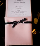 Pink napkin tied with black ribbon
