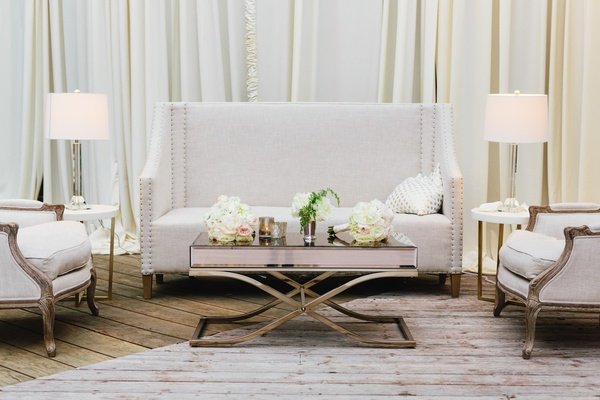 Wedding reception cocktail hour long furniture white settee and arm chair with lamps, side tables