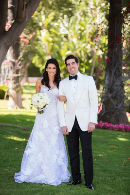 Morgan Rosen in a line Mira Zwillinger wedding dress and groom in tuxedo white jacket black bow tie