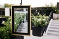wedding welcome sign on mirror with black and gold frame