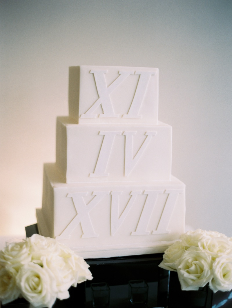 square three-tier wedding cake with wedding date in roman numerals