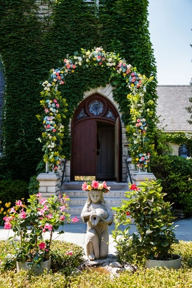 Wedding ceremony with flower arch outside angel flower details