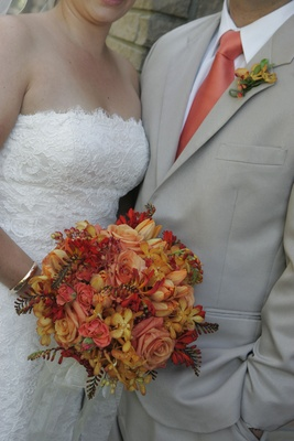 Red, yellow, and orange bridal bouquet