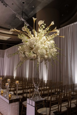 ceremony floral display with white flowers and calla lilies Chicago wedding NYE aisle runner