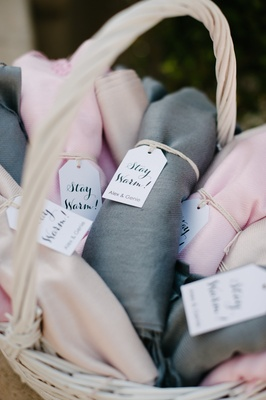 pink, beige, grey and gray pashminas for guests at outdoor wedding