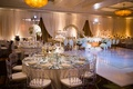 Dance floor white with custom gold monogram round tables with lucite acrylic chairs mirror top