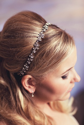 Blonde bride wearing crystal headpiece