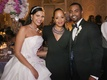 Bride in strapless Vera Wang wedding dress and sparkling headband and groom with Essence Atkins