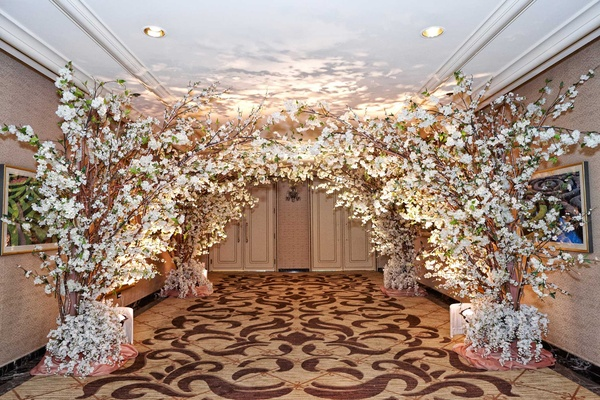 Ritz-Carlton Chicago hallway decorated with cherry blossom trees, white orchids