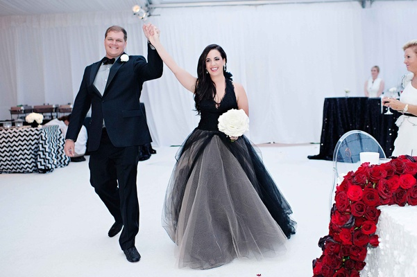 Bride in black Vera Wang dress and groom in black suit